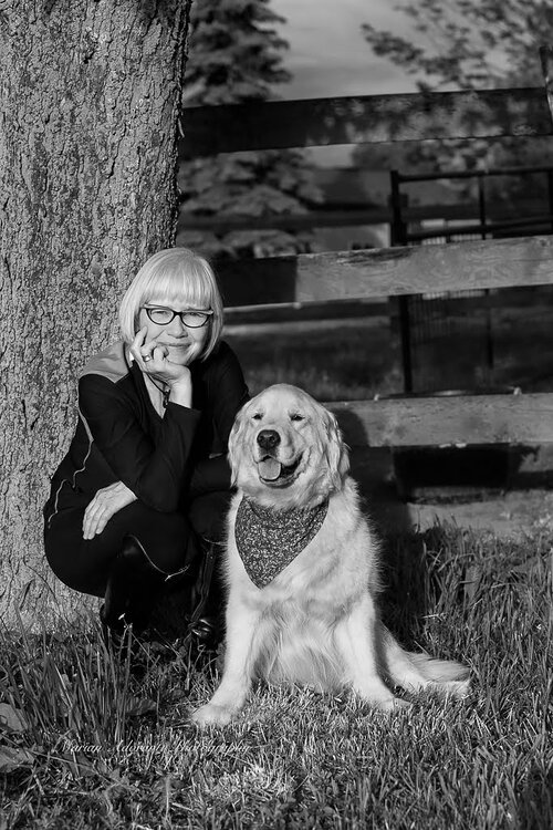 Black and white photo of woman and Golden retriever
