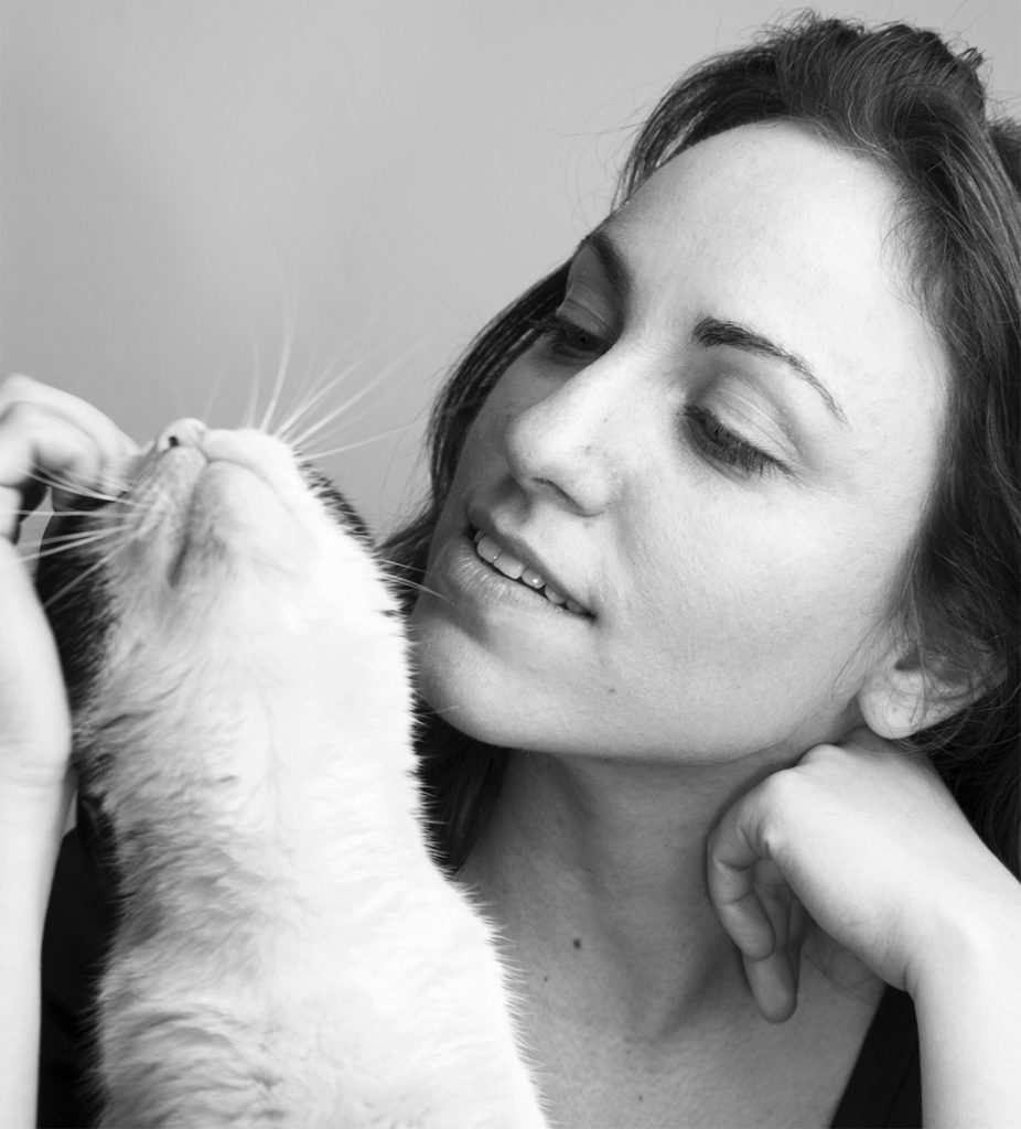 balck and white photo of woman and cat